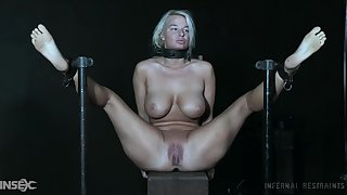 Busty blonde in imperturbable BDSM scenes