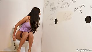 Eliza enjoying a gloryhole experience in a rest room room